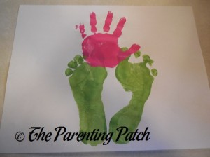 Pink Handprint Above Green Footprints
