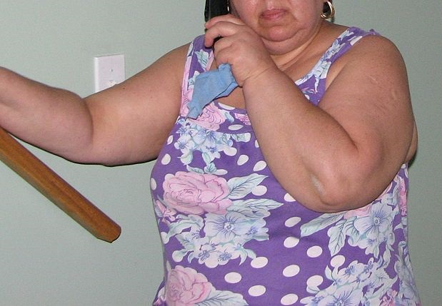 Obese Woman in Purple Outfit