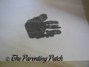 One Gray Handprint