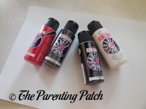 Red, Brown, Black, and White Acrylic Paint