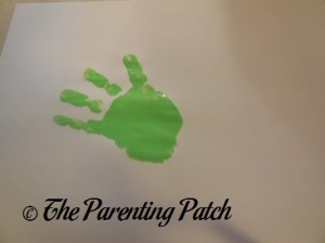 One Green Handprint
