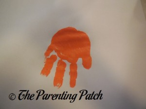One Orange Handprint