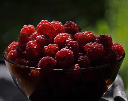 Raspberries in Clear Glass Bowl
