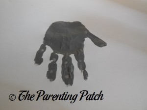 One Gray Handprint with Fingers Down