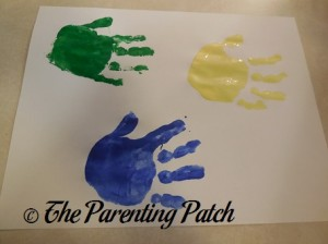 Green, Dark Blue, and Yellow Handprints