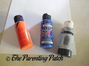 Orange, Blue, and Black Acrylic Paint
