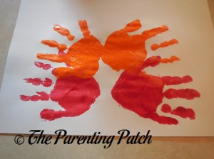 Two Orange Handprints and Two Red Handprints