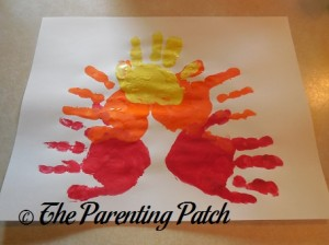 One Yellow Handprint, Two Orange Handprints, and Two Red Handprints