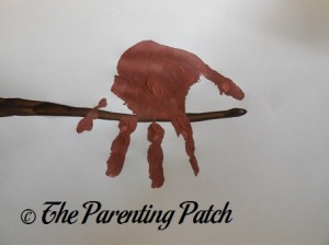 Light Brown Handprint on Dark Brown Branch
