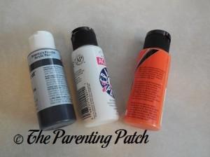 Black, White, and Orange Acrylic Paint