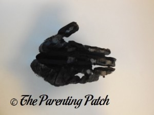 Black Handprint with Fingers Together and Thumb Up
