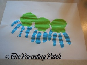 Three Handprints with Green Palms and Blue Fingers