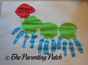 Adding One Red Palm Print to the Green and Blue Handprints