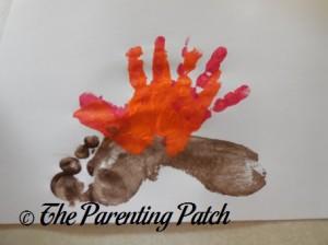Layering an Orange Handprint on the Red Handprint