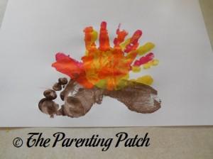 Layering a Yellow Handprint on the Orange Handprint