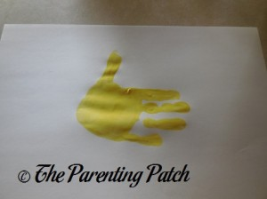 Yellow Handprint with Fingers Together and Thumb Up