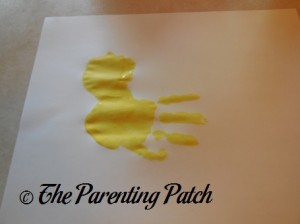Adding a Yellow Handprint to the Yellow Palm Print