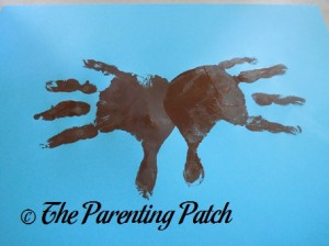 Two Brown Handprints with Fingers Open