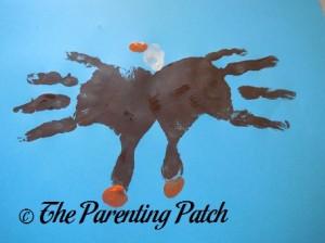 Adding Three Orange Fingerprints to the Brown Handprints and White Fingerprint