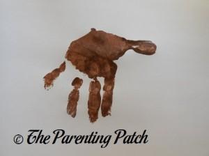 One Light Brown Handprint
