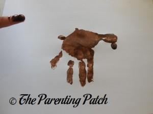Adding Dark Brown Fingertip Prints to the Light Brown Handprint