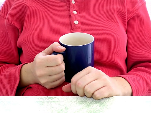 Overweight Woman Holding Mug