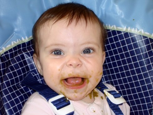 Baby Eating First Meal