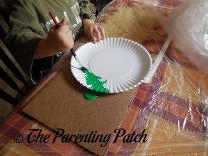 Painting the Paper Plate Green 1