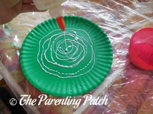 Pouring Glue on the Green Paper Plate