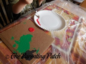 Painting the Paper Plate Red 1