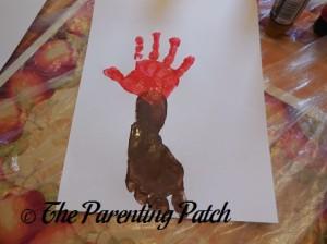 Adding a Red Handprint Above the Brown Footprint