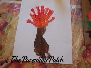 Layering an Orange Handprint onto the Red Handprint