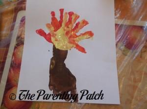 Layering a Yellow Handprint onto the Orange Handprint