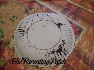 Drawing the Circle and Triangle Outlines in Black Marker