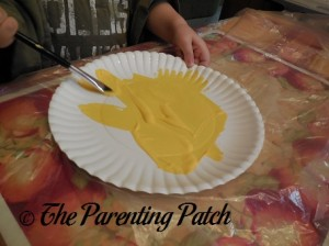 Painting the Paper Plate Yellow