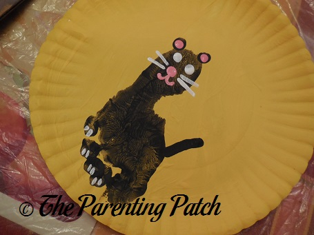 White Cat Eyes Whiskers and Toes Painting on Black Pupils · Full Moon Black Cat Paper Plate Craft & Full Moon Black Cat Paper Plate Craft | Parenting Patch