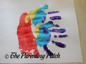 Adding Two Yellow, Blue, and Purple Handprints
