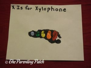 Completed X Is for Xylophone Footprint Craft