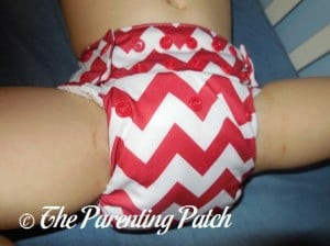 Front of Candy Cane Chevron Nicki's Diapers One-Size Bamboo All-in-One Cloth Diaper on Toddler 1