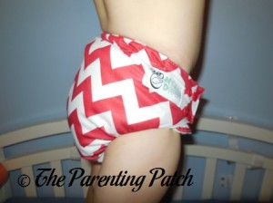 Side of Candy Cane Chevron Nicki's Diapers One-Size Bamboo All-in-One Cloth Diaper on Toddler