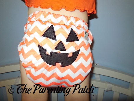 Back of Winning Colors Baby All-in-One Jack O' Lantern Cloth Diaper on Toddler 2