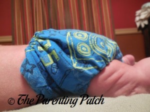 Side of StorkStopover Upcycled Newborn Fitted Pocket Cloth Diaper on Newborn 2