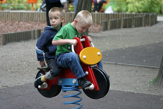 Boys on Toy Bike