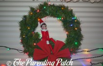 The Elf and the Lighted Wreath: The Elf on the Shelf Day 2