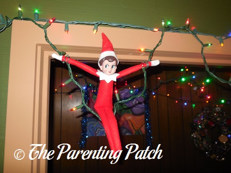 The Elf Swinging On The Christmas Lights The Elf On The
