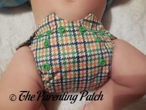 Front of Emerson Smart Bottoms Born Smart Newborn Diaper on Newborn at Four Months
