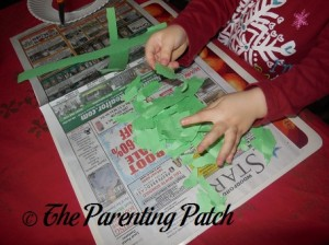 Tearing the Green Construction Paper
