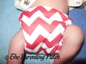 Front of Newborn Candy Cane Chevron Nicki's Diapers Pull-On Diaper Cover on Newborn