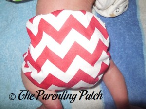 Side of Newborn Candy Cane Chevron Nicki's Diapers Pull-On Diaper Cover on Newborn 2