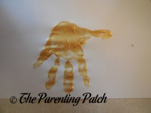 One Gold Handprint with Fingers Open